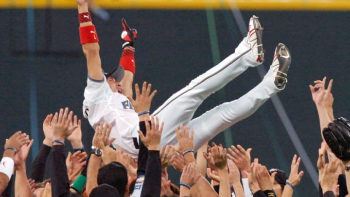 Former New York Mets outfielder Tsuyoshi Shinjo of the Pacific League champion Nippon Ham Fighters is tossed up in the air by his teammates as he will retire after this season while Fighter won the Japan Series of baseball games in Sapporo, Japan's northern island of Hokkaido 26 October 2006. Fighters defeated Central League champion Chunichi Dragons 4-1 and won the best-of-seven series 4-1. AFP PHOTO/JIJI PRESS (Photo by AFP / JIJI PRESS / AFP) / Japan OUT (Photo credit should read AFP/AFP via Getty Images)