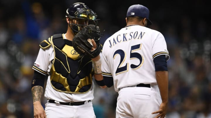 MILWAUKEE, WISCONSIN - SEPTEMBER 18: Yasmani Grandal #10 of the Milwaukee Brewers speaks with Jay Jackson #25 during the seventh inning against the San Diego Padres at Miller Park on September 18, 2019 in Milwaukee, Wisconsin. (Photo by Stacy Revere/Getty Images)