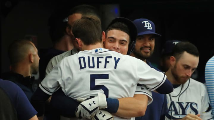ST PETERSBURG, FLORIDA - OCTOBER 07: Willy Adames #1 of the Tampa Bay Rays celebrates with Matt Duffy #5 after they both scored on a double by Austin Meadows #17 (not pictured) against the Houston Astros during the fourth inning in Game Three of the American League Division Series at Tropicana Field on October 07, 2019 in St Petersburg, Florida. (Photo by Mike Ehrmann/Getty Images)
