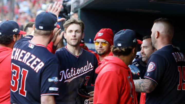 ST LOUIS, MISSOURI - OCTOBER 12: Trea Turner #7 of the Washington Nationals celebrates with pitcher Max Scherzer #31 in the dug out after scoring on a double by Adam Eaton #2 during the eighth inning of game two of the National League Championship Series against the St. Louis Cardinals at Busch Stadium on October 12, 2019 in St Louis, Missouri. (Photo by Scott Kane/Getty Images)