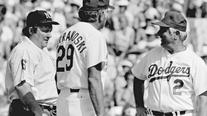 Ron Perranoski #29 and Tommy Lasorda #2 chat with umpire Bruce Froemming during a 1981 spring training game. (Photo by Jayne Kamin-Oncea/Getty Images)