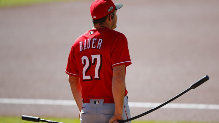 ATLANTA, GA - SEPTEMBER 30: Trevor Bauer #27 of the Cincinnati Reds warms up prior to Game One of the National League Wild Card Series between the Cincinnati Reds and Atlanta Braves at Truist Park on September 30, 2020 in Atlanta, Georgia. (Photo by Todd Kirkland/Getty Images)