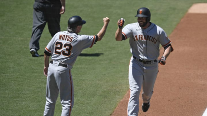 SAN DIEGO, CA - APRIL 7: Darin Ruf #33 of the SF Giants is congratulated by Ron Wotus after hitting a two-run home run during the second inning of a baseball game against the San Diego Padres at Petco Park on April 7, 2021 in San Diego, California. (Photo by Denis Poroy/Getty Images)