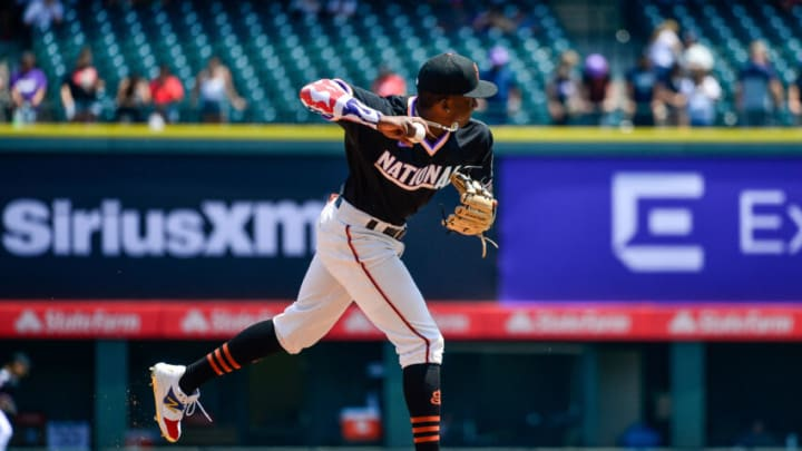 DENVER, CO - JULY 11: Marco Luciano #10 of National League Futures Team throws a ball as he warms up before a game against the American League Futures Team at Coors Field on July 11, 2021 in Denver, Colorado. Luciano is in the SF Giants organization. (Photo by Dustin Bradford/Getty Images)