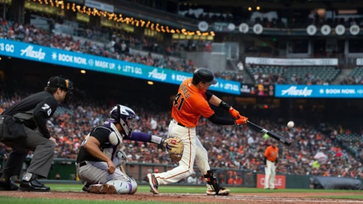 SAN FRANCISCO, CALIFORNIA - AUGUST 13: Wilmer Flores #41 of the San Francisco Giants hits a three run home run against the Colorado Rockies during the first inning at Oracle Park on August 13, 2021 in San Francisco, California. (Photo by Jason O. Watson/Getty Images)