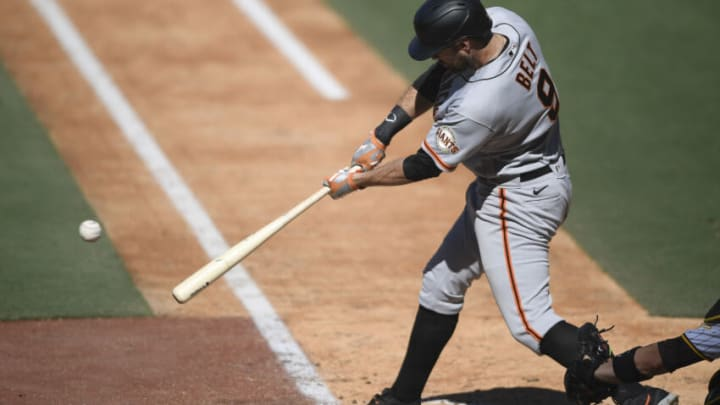 SAN DIEGO, CA - SEPTEMBER 23: Brandon Belt #9 of the San Francisco Giants hits a single during the sixth inning of a baseball game against the San Diego Padres at Petco Park on September 23, 2021 in San Diego, California. (Photo by Denis Poroy/Getty Images)