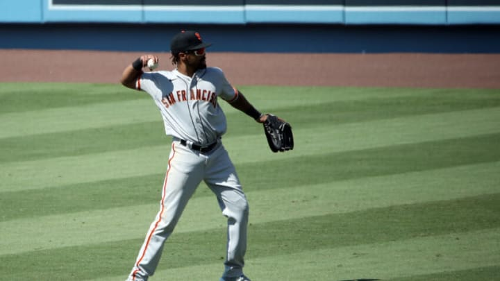 LOS ANGELES, CALIFORNIA - JULY 25: Jaylin Davis #49 of the SF Giants warms up in between innings against the Los Angeles Dodgers at Dodger Stadium on July 25, 2020 in Los Angeles, California. The 2020 season had been postponed since March due to the COVID-19 pandemic. (Photo by Katelyn Mulcahy/Getty Images)