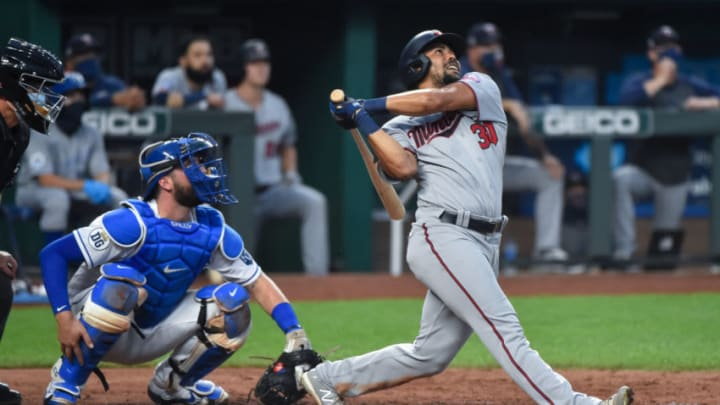 LaMonte Wade Jr. #30 during his time with the Minnesota Twins hits in the sixth inning against the Kansas City Royals at Kauffman Stadium on August 9, 2020 in Kansas City, Missouri. (Photo by Ed Zurga/Getty Images)