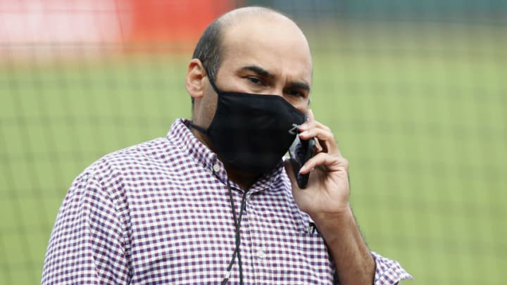 SAN FRANCISCO, CALIFORNIA - AUGUST 26: President of Baseball Operations Farhan Zaidi of the San Francisco Giants talks on the phone before the postponement of the game against the Los Angeles Dodgers at Oracle Park on August 26, 2020 in San Francisco, California. Several sporting leagues across the nation today are postponing their schedules as players protest the shooting of Jacob Blake by Kenosha, Wisconsin police. (Photo by Lachlan Cunningham/Getty Images)