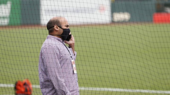 SAN FRANCISCO, CALIFORNIA - AUGUST 26: San Francisco Giants President of Baseball Operations, Farhan Zaidi, talks on the phone before the postponement of the game against the Los Angeles Dodgers at Oracle Park on August 26, 2020 in San Francisco, California.(Photo by Lachlan Cunningham/Getty Images)