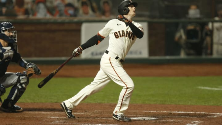 SAN FRANCISCO, CALIFORNIA - SEPTEMBER 09: Mike Yastrzemski #5 of the San Francisco Giants hits a three-run home run in the bottom of the third inning against the Seattle Mariners at Oracle Park on September 09, 2020 in San Francisco, California. (Photo by Lachlan Cunningham/Getty Images)