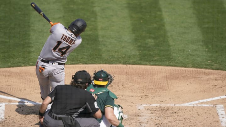 OAKLAND, CALIFORNIA - SEPTEMBER 20: Chadwick Tromp #14 of the SF Giants hits a base hit against the Oakland Athletics in the top of the fifth inning at RingCentral Coliseum on September 20, 2020 in Oakland, California. (Photo by Thearon W. Henderson/Getty Images)