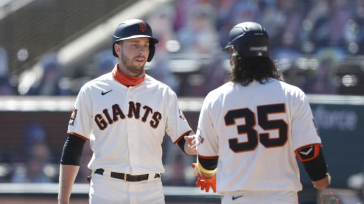 SAN FRANCISCO, CALIFORNIA - SEPTEMBER 24: Austin Slater #13 of the San Francisco Giants celebrates with Brandon Crawford #35 after scoring on a single by Wilmer Flores #41 in the bottom of the first inning against the Colorado Rockies at Oracle Park on September 24, 2020 in San Francisco, California. (Photo by Lachlan Cunningham/Getty Images)