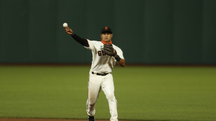 Donovan Solano #7 of the SF Giants fields the ball against the Colorado Rockies at Oracle Park on September 23, 2020 in San Francisco, California. (Photo by Lachlan Cunningham/Getty Images)