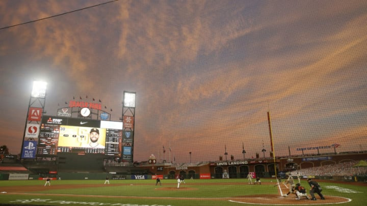 SAN FRANCISCO, CALIFORNIA - SEPTEMBER 26: Eric Hosmer #30 of the San Diego Padres hits a single in the top of the fourth inning against the San Francisco Giants at Oracle Park on September 26, 2020 in San Francisco, California. (Photo by Lachlan Cunningham/Getty Images)