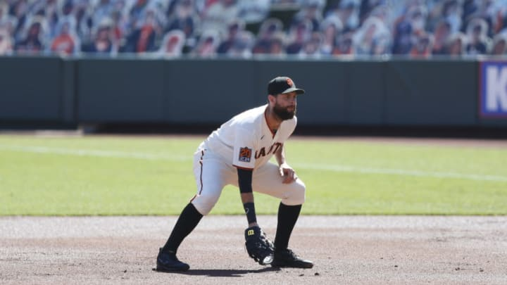 SAN FRANCISCO, CALIFORNIA - SEPTEMBER 24: Brandon Belt #9 of the San Francisco Giants fields at first base against the Colorado Rockies at Oracle Park on September 24, 2020 in San Francisco, California. (Photo by Lachlan Cunningham/Getty Images)