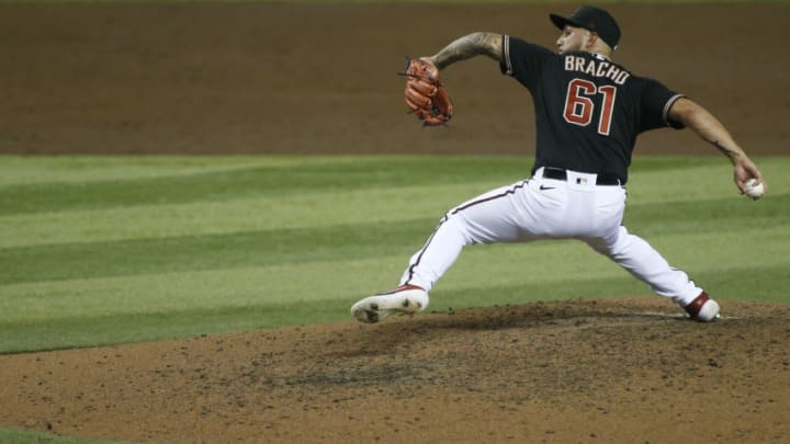 PHOENIX, ARIZONA - SEPTEMBER 26: Relief pitcher Silvino Bracho #61 of the Arizona Diamondbacks throws a pitch against the Colorado Rockies during the sixth inning of the MLB game at Chase Field on September 26, 2020 in Phoenix, Arizona. (Photo by Ralph Freso/Getty Images)