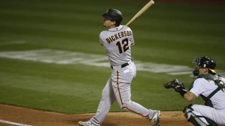 Alex Dickerson #12 of the SF Giants bats during the game against the Oakland Athletics at RingCentral Coliseum on September 18, 2020 in Oakland, California. (Photo by Michael Zagaris/Oakland Athletics/Getty Images)