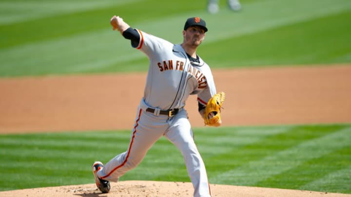 Kevin Gausman #34 of the SF Giants pitches during the game against the Oakland Athletics at RingCentral Coliseum on September 19, 2020. (Photo by Michael Zagaris/Oakland Athletics/Getty Images)