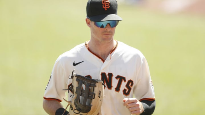 SAN FRANCISCO, CALIFORNIA - SEPTEMBER 27: Mike Yastrzemski #5 of the San Francisco Giants walks to the dugout during the game against the San Diego Padres at Oracle Park on September 27, 2020 in San Francisco, California. (Photo by Lachlan Cunningham/Getty Images)