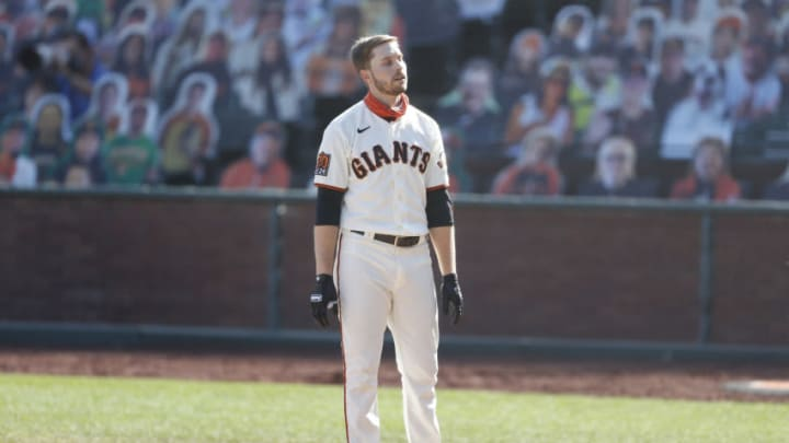 A dejected Austin Slater after striking out to end the SF Giants season. (Photo by Lachlan Cunningham/Getty Images)