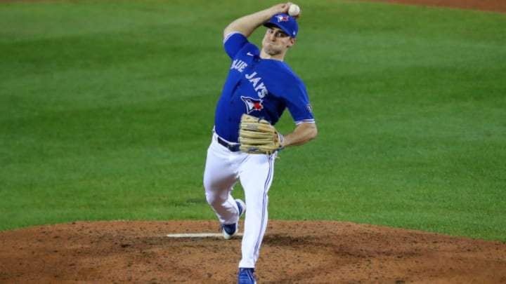 """BUFFALO, NY - SEPTEMBER 23: Ross Stripling #48 of the Toronto Blue Jays throws a pitch against the New York Yankees at Sahlen Field on September 23, 2020 in Buffalo, New York. The Blue Jays are the home team due to the Canadian government""""u2019s policy on COVID-19, which prevents them from playing in their home stadium in Canada. Blue Jays beat the Yankees 14 to 1. (Photo by Timothy T Ludwig/Getty Images)"""