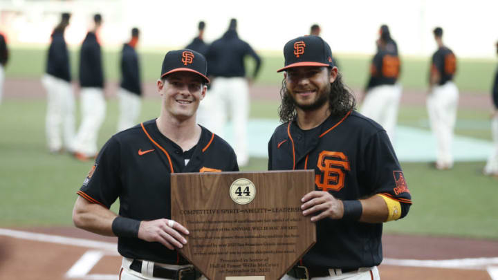 SAN FRANCISCO, CALIFORNIA - SEPTEMBER 26: Mike Yastrzemski #5 of the SF Giants is presented with the 2020 Willie Mac Award by teammate Brandon Crawford #35 before the game against the San Diego Padres at Oracle Park on September 26, 2020 in San Francisco, California. (Photo by Lachlan Cunningham/Getty Images)