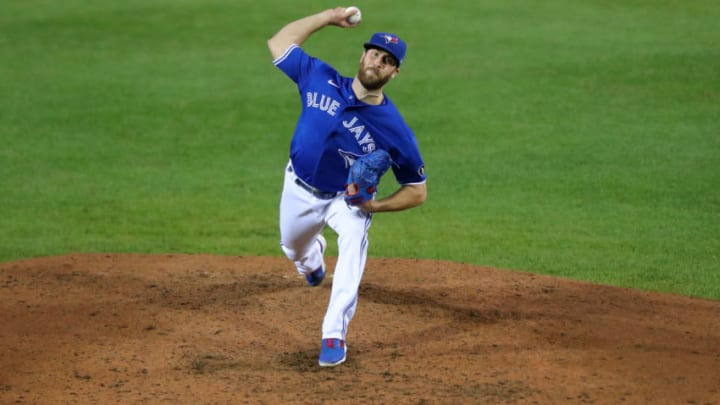 """BUFFALO, NY - SEPTEMBER 24: Anthony Bass #52 of the Toronto Blue Jays throws a pitch against the New York Yankees at Sahlen Field on September 24, 2020 in Buffalo, New York. The Blue Jays are the home team due to the Canadian government""""u2019s policy on COVID-19, which prevents them from playing in their home stadium in Canada. Blue Jays beat the Yankees 4 to 1. (Photo by Timothy T Ludwig/Getty Images)"""