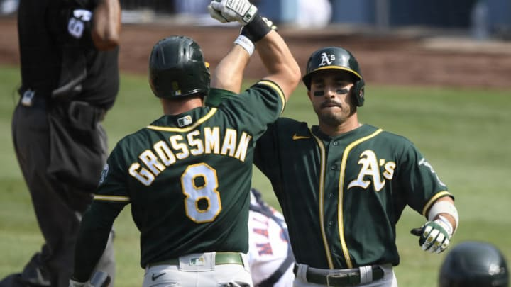 LOS ANGELES, CALIFORNIA - OCTOBER 08: Ramon Laureano #22 of the Oakland Athletics celebrates a solo home run with teammate Robbie Grossman #8 during the fifth inning against the Oakland Athletics in Game Four of the American League Division Series at Dodger Stadium on October 08, 2020 in Los Angeles, California. (Photo by Kevork Djansezian/Getty Images)