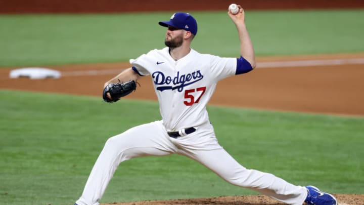 ARLINGTON, TEXAS - OCTOBER 21: Alex Wood #57 of the Los Angeles Dodgers delivers the pitch against the Tampa Bay Rays during the eighth inning in Game Two of the 2020 MLB World Series at Globe Life Field on October 21, 2020 in Arlington, Texas. (Photo by Tom Pennington/Getty Images)