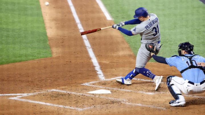 ARLINGTON, TEXAS - OCTOBER 25: Joc Pederson #31 of the Los Angeles Dodgers hits a solo home run against the Tampa Bay Rays during the second inning in Game Five of the 2020 MLB World Series at Globe Life Field on October 25, 2020 in Arlington, Texas. (Photo by Sean M. Haffey/Getty Images)