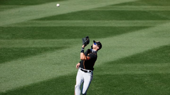 Outfielder Hunter Bishop #95 of the SF Giants catches a fly-ball out against the Texas Rangers during the fourth inning of the MLB spring training game on March 01, 2021 in Surprise, Arizona. (Photo by Christian Petersen/Getty Images)