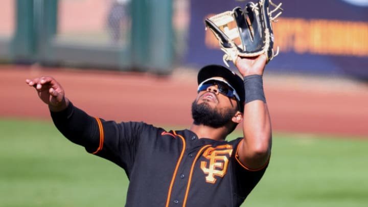Heliot Ramos #80 of the SF Giants makes a catch during the sixth inning of a spring training game against the Chicago White Sox at Scottsdale Stadium on March 04, 2021 in Scottsdale, Arizona. (Photo by Carmen Mandato/Getty Images)