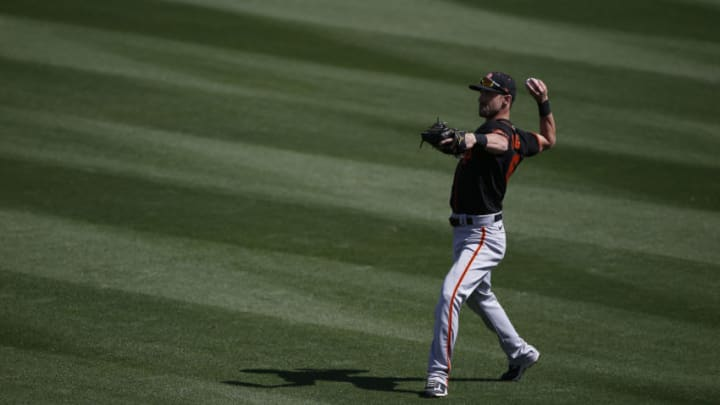 TEMPE, ARIZONA - MARCH 11: Steven Duggar #6 of the SF Giants warms up prior to the MLB spring training baseball game against of the Los Angeles Angels at Tempe Diablo Stadium on March 11, 2021 in Tempe, Arizona. (Photo by Ralph Freso/Getty Images)