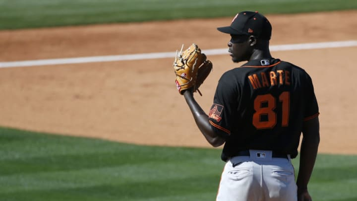 TEMPE, ARIZONA - MARCH 11: Pitcher Yunior Marte #81 of the SF Giants prepares to throw against the Los Angeles Angels during the fifth inning of the MLB spring training baseball game at Tempe Diablo Stadium on March 11, 2021 in Tempe, Arizona. (Photo by Ralph Freso/Getty Images)