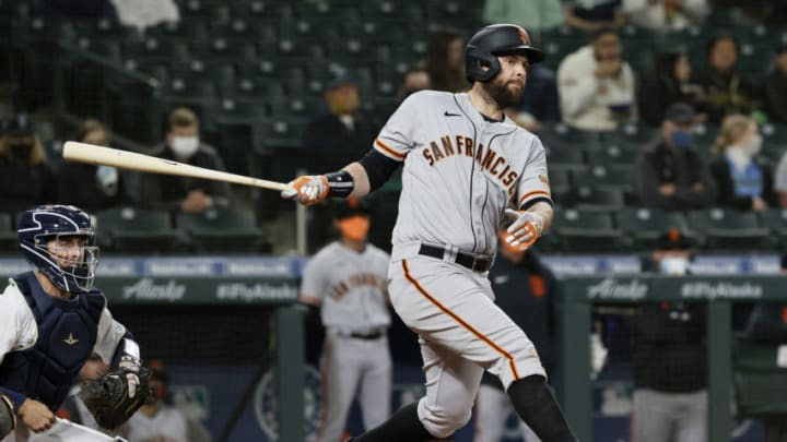 SEATTLE, WASHINGTON - APRIL 01: Brandon Belt #9 of the SF Giants at bat against the Seattle Mariners in the fourth inning on Opening Day at T-Mobile Park on April 01, 2021 in Seattle, Washington. (Photo by Steph Chambers/Getty Images)