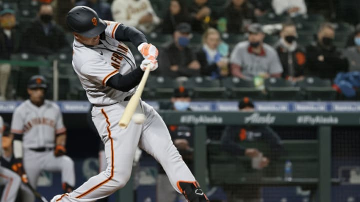 SEATTLE, WASHINGTON - APRIL 01: Buster Posey #28 of the San Francisco Giants at bat against the Seattle Mariners in the fourth inning on Opening Day at T-Mobile Park on April 01, 2021 in Seattle, Washington. (Photo by Steph Chambers/Getty Images)