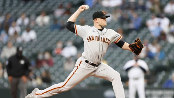 SEATTLE, WASHINGTON - APRIL 03: Logan Webb #62 of the SF Giants pitches against the Seattle Mariners in the first inning at T-Mobile Park on April 03, 2021 in Seattle, Washington. (Photo by Steph Chambers/Getty Images)