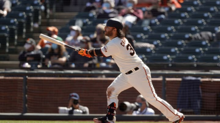 SAN FRANCISCO, CALIFORNIA - APRIL 10: Brandon Crawford #35 of the San Francisco Giants hits a three-run home run in the sixth inning against the Colorado Rockies at Oracle Park on April 10, 2021 in San Francisco, California. (Photo by Ezra Shaw/Getty Images)
