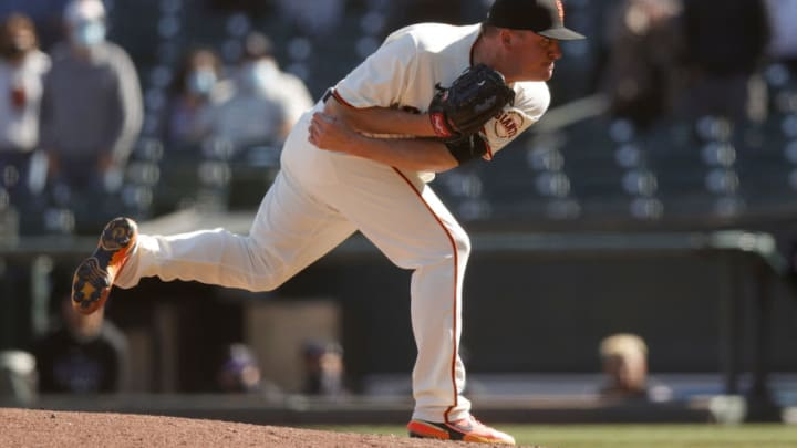 SAN FRANCISCO, CALIFORNIA - APRIL 10: Jake McGee #17 of the San Francisco Giants pitches against the Colorado Rockies in the ninth inning at Oracle Park on April 10, 2021 in San Francisco, California. (Photo by Ezra Shaw/Getty Images)
