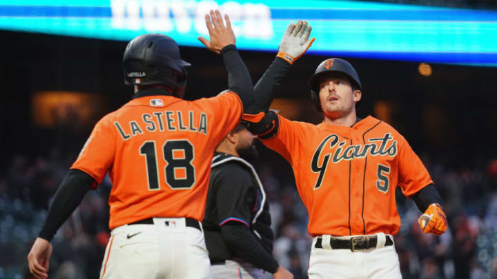 SAN FRANCISCO, CALIFORNIA - APRIL 23: Mike Yastrzemski #5 of the San Francisco Giants celebrates a two-run home run with Tommy La Stella #18 during the third inning against the Miami Marlins at Oracle Park on April 23, 2021 in San Francisco, California. (Photo by Daniel Shirey/Getty Images)