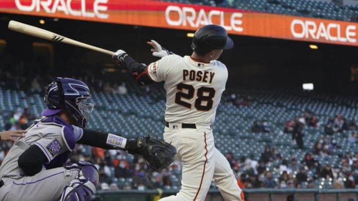 SAN FRANCISCO, CALIFORNIA - APRIL 26: Buster Posey #28 of the San Francisco Giants hits an rbi double scoring Brandon Belt #9 against the Colorado Rockies in the first inning at Oracle Park on April 26, 2021 in San Francisco, California. (Photo by Thearon W. Henderson/Getty Images)