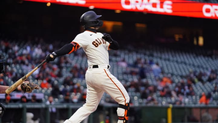 SAN FRANCISCO, CALIFORNIA - APRIL 22: Tommy La Stella #18 of the San Francisco Giants bats during the game against the Miami Marlins at Oracle Park on April 22, 2021 in San Francisco, California. (Photo by Daniel Shirey/Getty Images)