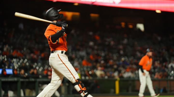 SAN FRANCISCO, CALIFORNIA - APRIL 23: Tommy La Stella #18 of the San Francisco Giants bats during the game against the Miami Marlins at Oracle Park on April 23, 2021 in San Francisco, California. (Photo by Daniel Shirey/Getty Images)