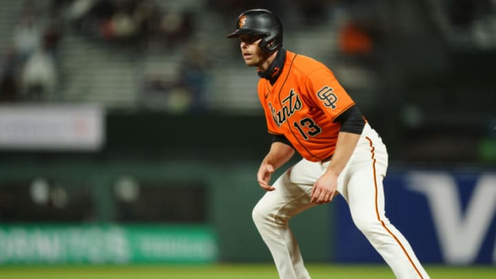 SAN FRANCISCO, CALIFORNIA - APRIL 23: Austin Slater #13 of the San Francisco Giants takes a lead at first during the game against the Miami Marlins at Oracle Park on April 23, 2021 in San Francisco, California. (Photo by Daniel Shirey/Getty Images)