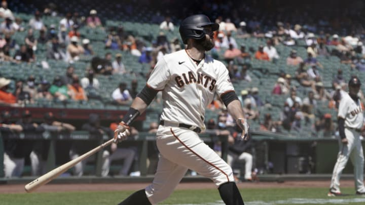 SAN FRANCISCO, CALIFORNIA - MAY 11: Brandon Belt #9 of the San Francisco Giants bats against the Texas Rangers in the first inning at Oracle Park on May 11, 2021 in San Francisco, California. (Photo by Thearon W. Henderson/Getty Images)