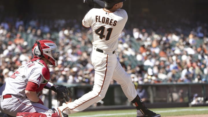 SAN FRANCISCO, CALIFORNIA - MAY 31: Wilmer Flores #41 of the San Francisco Giants hits an RBI double scoring Steven Duggar #6 against the Los Angeles Angels in the bottom of the seventh inning at Oracle Park on May 31, 2021 in San Francisco, California. (Photo by Thearon W. Henderson/Getty Images)