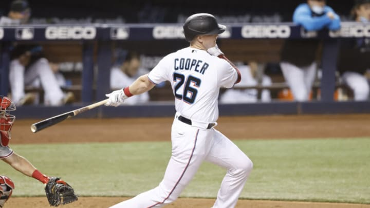 MIAMI, FLORIDA - MAY 24: Garrett Cooper #26 of the Miami Marlins in action against the Philadelphia Phillies at loanDepot park on May 24, 2021 in Miami, Florida. (Photo by Michael Reaves/Getty Images)