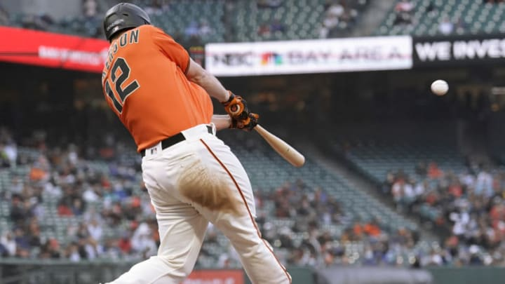 SAN FRANCISCO, CALIFORNIA - JUNE 04: Alex Dickerson #12 of the San Francisco Giants hits a three-run home run against the Chicago Cubs in the bottom of the second inning at Oracle Park on June 04, 2021 in San Francisco, California. (Photo by Thearon W. Henderson/Getty Images)