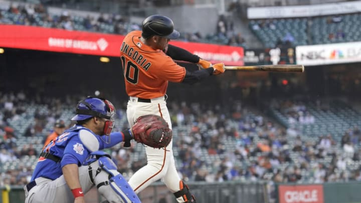 SAN FRANCISCO, CALIFORNIA - JUNE 04: Evan Longoria #10 of the San Francisco Giants hit an RBI single scoring Brandon Crawford #35 against the Chicago Cubs in the bottom of the second inning at Oracle Park on June 04, 2021 in San Francisco, California. (Photo by Thearon W. Henderson/Getty Images)
